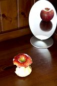 picture of anorexia  - Apple in the mirror on wooden background anorexia concept - JPG