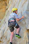 Teen Climbing Rock