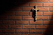 crucifix with Jesus on brick wall