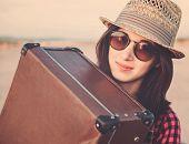 Hipster Girl Traveler Hugging A Suitcase