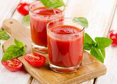 Tomato Juice And Fresh Tomatoes  On  Wooden Background