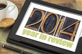 2014 year in review - text in letterpress wood type on a digital tablet with cup of coffee