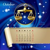 picture of libra  - Simple monthly page of 2015 Calendar with gold zodiacal sign against the blue star space background - JPG