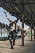 Pretty Girl Posing In A Metro Station