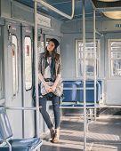 Pretty Girl Posing In A Metro Car
