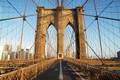 stock photo of pedestrian crossing  - Brooklyn Bridge at sunrise - JPG