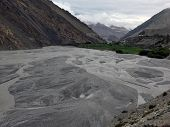 image of mustang  - A river delta near the agricultural town of Kagbeni in the Annapurna Himalayas of Mustang Nepal during monsoon - JPG