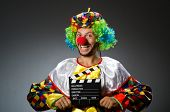 Clown with movie clapper board