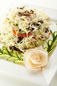 Chinese Food - Salad with Cabbage, Meat and Vegetables. Garnished with Cucumber
