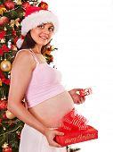 Pregnant  woman holding red Christmas box.