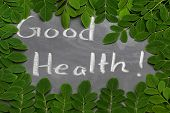 Moringa Leaves With Good Health Written In A Slate