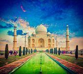 Vintage retro effect filtered hipster style image of  Taj Mahal on sunrise sunset, Indian Symbol - India travel background. Agra, Uttar Pradesh, India