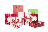 Stack of Christmas gifts and giftbags isolated on white background