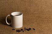 Coffee Mug Closeup - White Mug With Beans