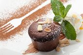 stock photo of icing  - Warm dessert chocolate cake Fondant served on plate with ice - JPG