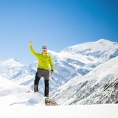 Climbing Success In Winter Snowy Mountains