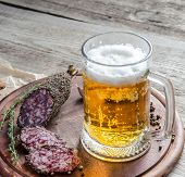 Slices Of French Sausage With Glass Of Beer