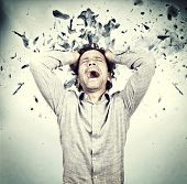stressed man and background explosion
