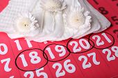 picture of menses  - Sanitary pads and white flowers on red calendar background - JPG