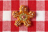 Christmas homemade gingerbread cookie on tablecloth