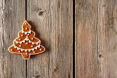 Christmas homemade gingerbread cookie on wooden table