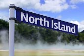 North Island, New Zealand sign on a beautiful landscape background