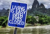 Living is Easy With Eyes Closed sign with a exotic background