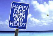 picture of loveless  - Happy Face With Sad Heart sign with a beach on background - JPG