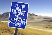 In The End We Only Regret The Changes We Didn't Take sign with a desert background