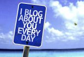 I Blog About You Every Day sign with a beach on background