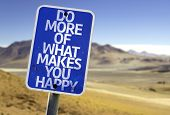 Do More Of What Makes You Happy sign with a desert background