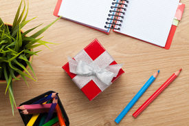 pic of office romance  - Red gift box and office supplies over office table - JPG