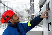 picture of substation  - The electrician examines the equipment on electric substation - JPG