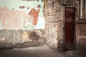 stock photo of lock  - Abstract empty abandoned urban interior fragment old colorful wall and locked rusted door - JPG