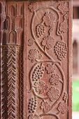 stock photo of emperor  - Architectural detail of grapes carved into the wall of the palace of Fatehpur Sikri ancient city founded by Mughal emperor Akbar one of the best preserved collections of Indian Mughal architecture in Agra Uttar Pradesh India - JPG
