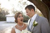 pic of married  - Newly married couple together with surprised look - JPG