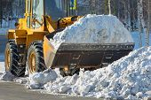 foto of bulldozer  - The bulldozer cleans from the road old snow - JPG