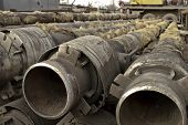 stock photo of glass-wool  - Old metal pipes are cleaned from glass wool - JPG