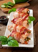 pic of bacon strips  - Delicious chicken rolls stuffed with green beans and carrots wrapped in strips of bacon - JPG