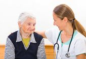 stock photo of geriatric  - Photo of elderly woman with the young doctor - JPG
