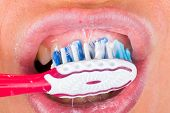 foto of toothpaste  - Close up photo of tooth brushing with toothpaste - JPG
