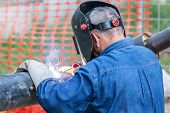 foto of pipe-welding  - welder with protection mask - JPG