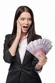 foto of exciting  - Excited woman with euro money in hand - JPG