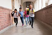 picture of pupils  - Cute pupils running down the hall at the elementary school - JPG