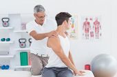 pic of medical  - Doctor doing back adjustment in medical office - JPG