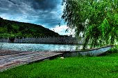 foto of pontoon boat  - Boat at shore of lake by the pontoon - JPG