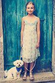 foto of maltese  - Lovely fashion girl with maltese dog - JPG