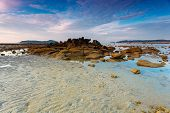 stock photo of tide  - beautiful sunrise at the tropical andaman sea diring tide - JPG
