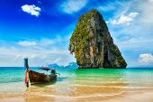 Tropical vacation holiday beach concept - Long tail boat on tropical beach, Krabi, Thailand poster