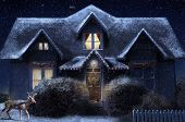 foto of gabled dormer window  - A warm inviting winter cottage with a deer wandering through the front yard - JPG